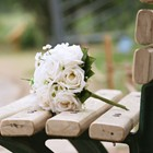 A wedding bouquet on a side road bench.