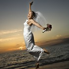 A leaping bride on the beach.